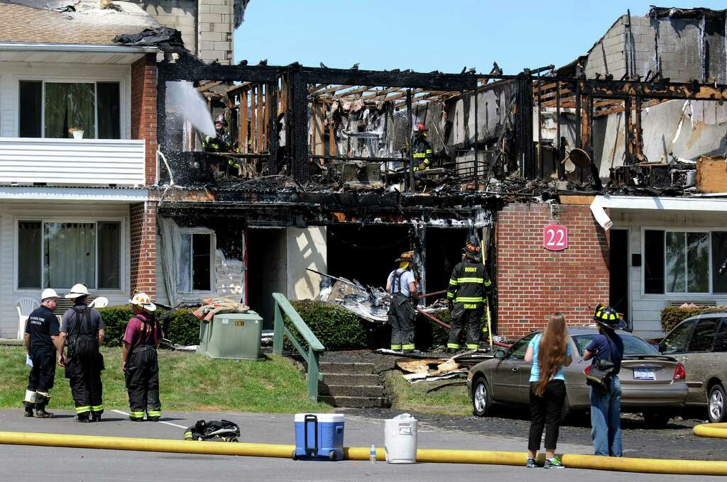 Firefighters Douse A Fire On Saturday, Aug. 17, 2013, At Valley View