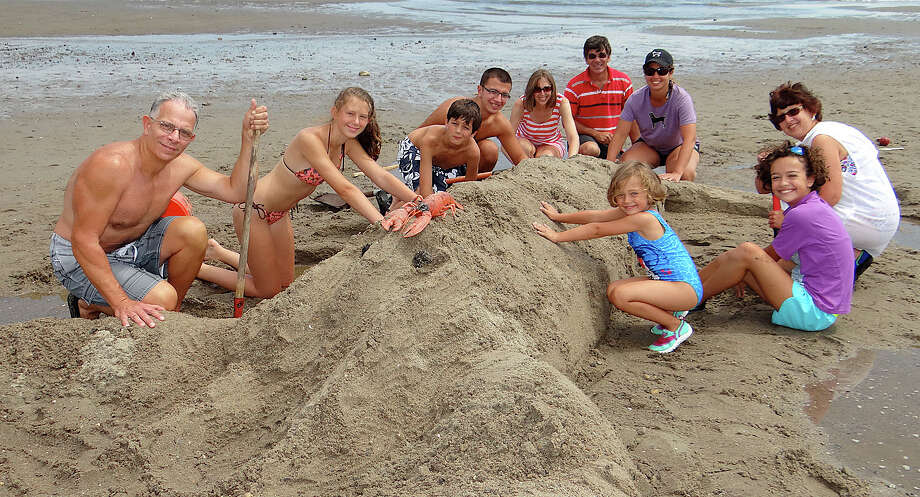 The Aults of Southport, Savianos of Southport and Derenches of Enfield collaborate to create a lobster at Fairfield PAL's Sand Sculpture Contest at Penfield Beach.  FAIRFIELD CITIZEN, CT 8/17/13 Photo: Mike Lauterborn / Fairfield Citizen contributed