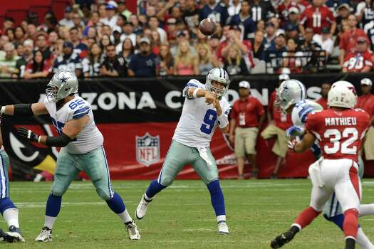 GLENDALE, AZ - AUGUST 17:  Tony Romo #9 of the Dallas Cowboys throws a pass up field against the Arizona Cardinals at University of Phoenix Stadium on August 17, 2013 in Glendale, Arizona. Photo: Norm Hall, Getty Images / 2013 Getty Images