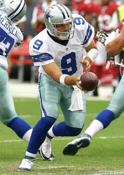 Dallas Cowboys quarterback Tony Romo (9) hands off against the Arizona Cardinals during the first half of a preseason NFL football  game, Saturday, Aug. 17, 2013, in Glendale, Ariz. (AP Photo/Ross D. Franklin) Photo: Ross D. Franklin, Associated Press / AP