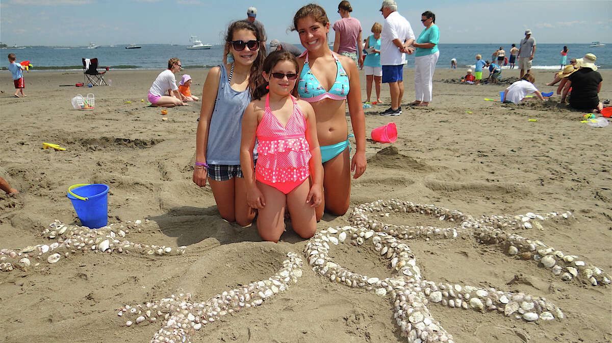 Mikaela and Ariana Roca, ages 14 and 10, with Emma Roca, 14 and their sand sculpture