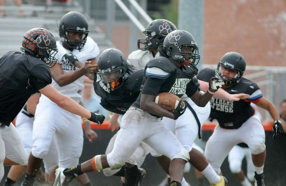 St. Pius senior Corinthians Walker will not only carry the ball this season but also lead the experienced Panthers' defense. Photo: Jerry Baker, Freelance