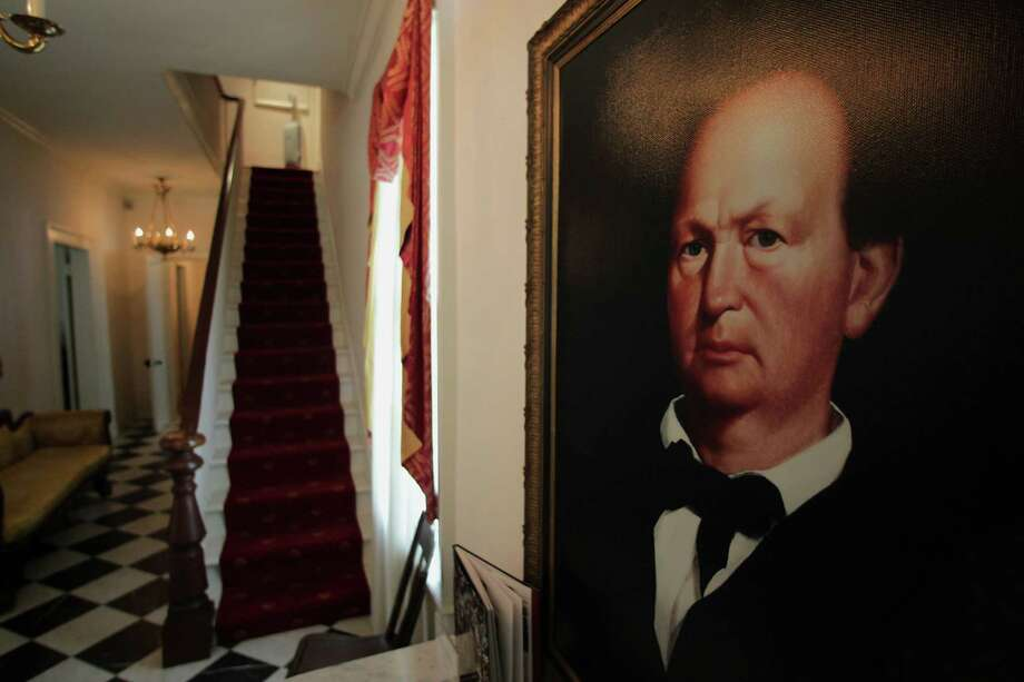A portrait of Menard hangs in his historical home on the island, where ghosts of children and a spurned lover have purportedly been sighted. Photo: James Nielsen, Staff / © 2013  Houston Chronicle
