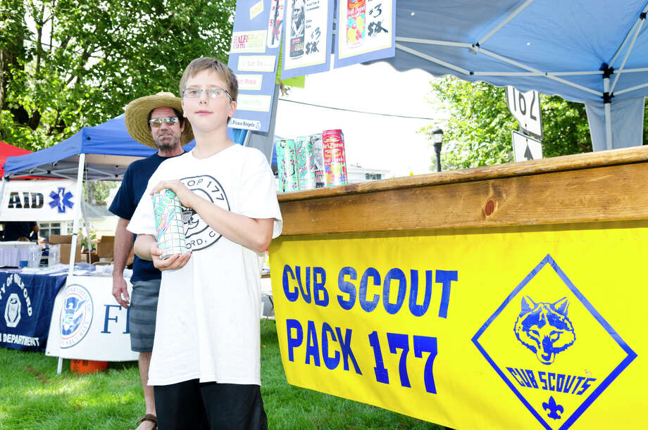 Daniel Esposito, 11, of Stratford Boy Scout Troop 177, sells ice cold Arizona Iced Tea to support Stratford Cub Scout Pack 177 during the 39th annual Milford Oyster Festival in downtown Milford on Saturday, Aug. 17, 2013. Photo: Amy Mortensen / Connecticut Post Freelance