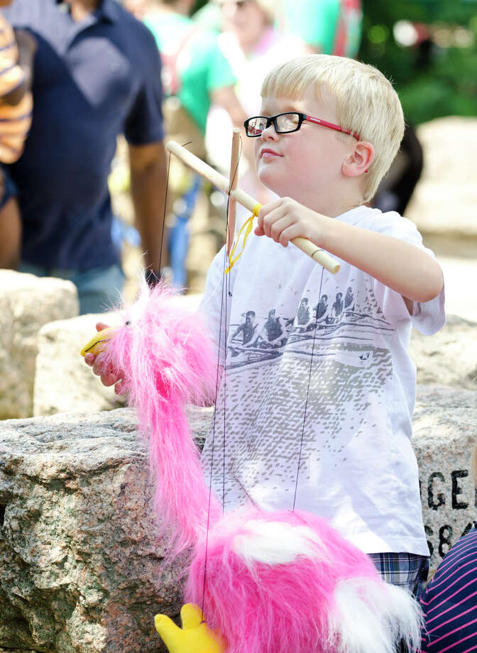 Stewart Keith, 5, of Manchester, manipulates the strings on a marionette during the 39th annual Milford Oyster Festival in downtown Milford on Saturday, Aug. 17, 2013. Photo: Amy Mortensen / Connecticut Post Freelance