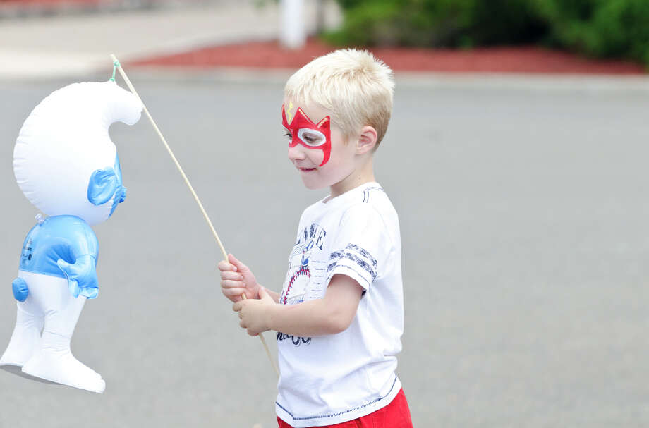 Shane Simpson, 5, of Milford, plays with a Smurf balloon during the 39th annual Milford Oyster Festival in downtown Milford on Saturday, Aug. 17, 2013. Photo: Amy Mortensen / Connecticut Post Freelance