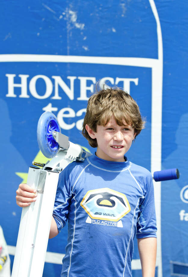 Daniel Folloni, 8, of Milford, holds a Razor scooter that he won from the Honest Tea booth for collecting 500 recyclable cans and bottles during the 39th annual Milford Oyster Festival in downtown Milford on Saturday, Aug. 17, 2013. Photo: Amy Mortensen / Connecticut Post Freelance