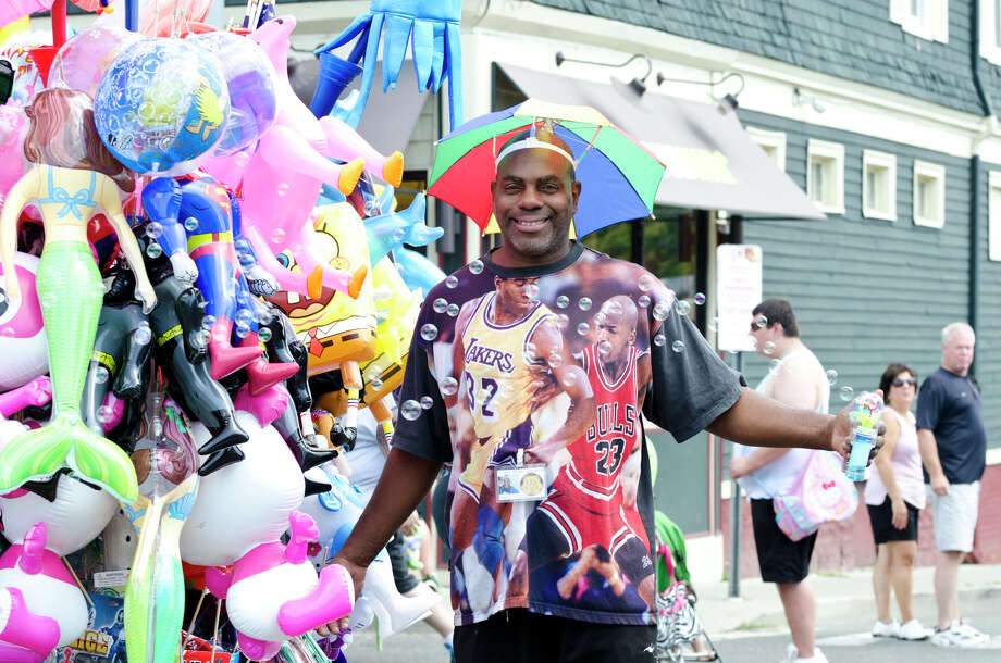 Thomas Blackman, of T&J Balloons, sells his wares during the 39th annual Milford Oyster Festival in downtown Milford on Saturday, Aug. 17, 2013. Photo: Amy Mortensen / Connecticut Post Freelance
