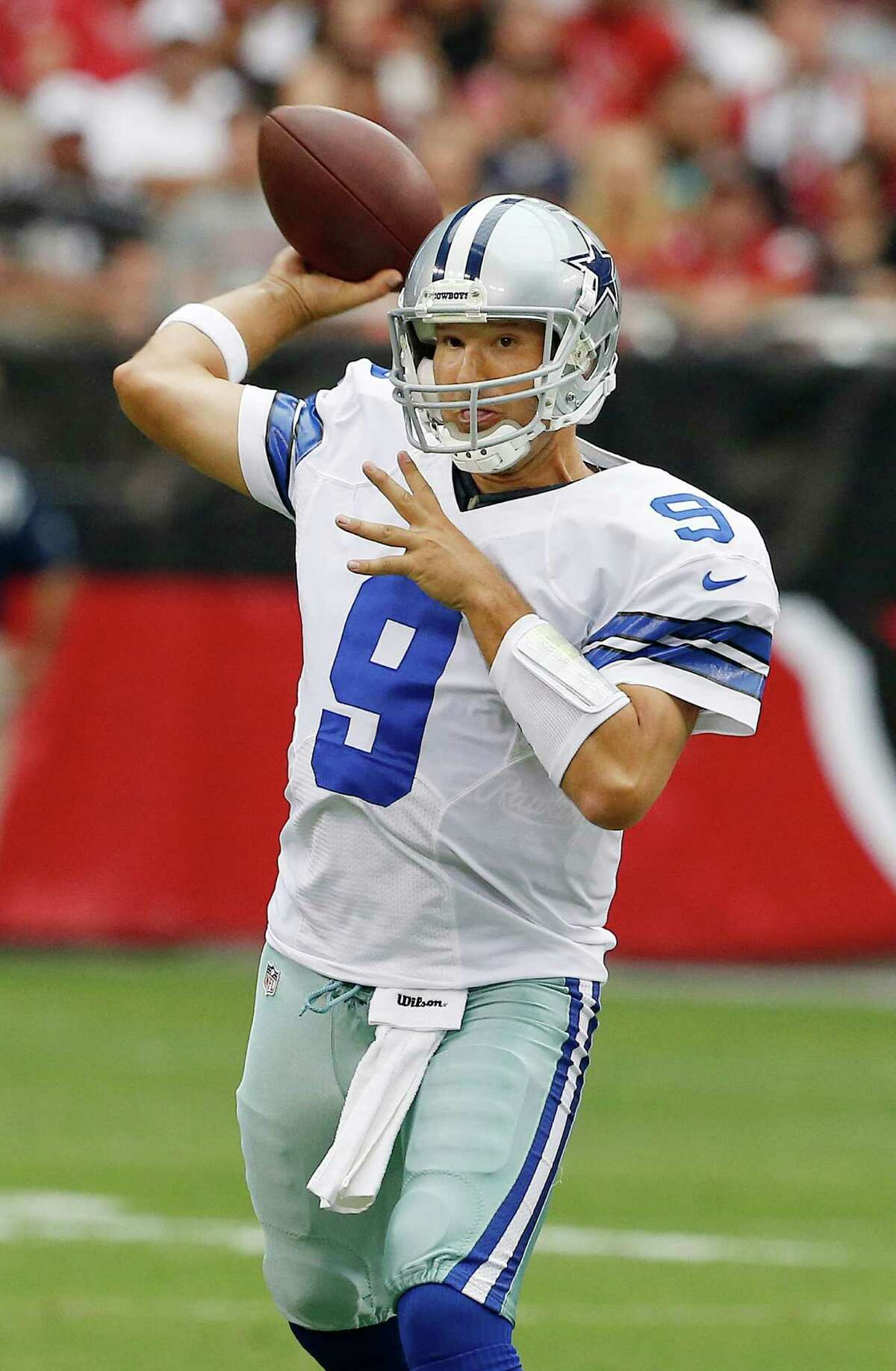 Dallas Cowboys' Tony Romo passes against the Arizona Cardinals in the first half during a preseason NFL football game on Saturday, Aug. 17, 2013, in Glendale, Ariz.