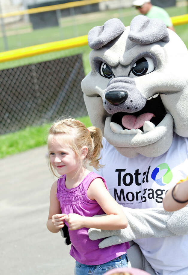 Abbey Innamorato, 4, of Clinton, poses for a photo with the Yale Bulldog during the 39th annual Milford Oyster Festival in downtown Milford on Saturday, Aug. 17, 2013. Photo: Amy Mortensen / Connecticut Post Freelance