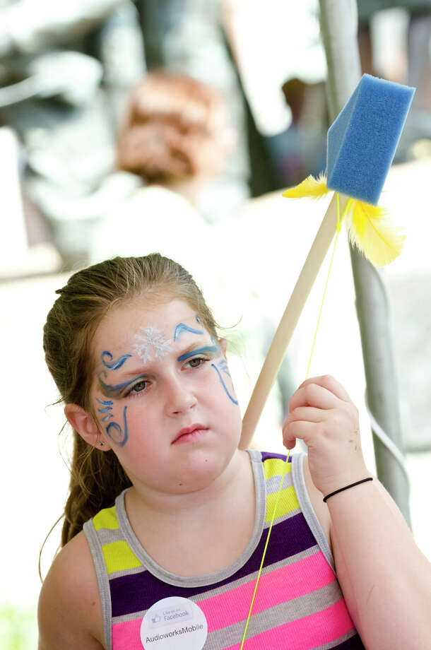 Caitlin Welch, 9, of West Haven, holds a foam bow and arrow during the 39th annual Milford Oyster Festival in downtown Milford on Saturday, Aug. 17, 2013. Photo: Amy Mortensen / Connecticut Post Freelance