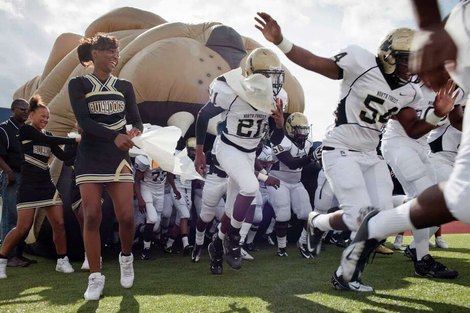 North Forest  players  will run onto the field as part of the Houston Independent School District  this season, and with them will be  their new coach, Mike Ferrell. Photo: Eric Kayne / © 2012 Eric Kayne
