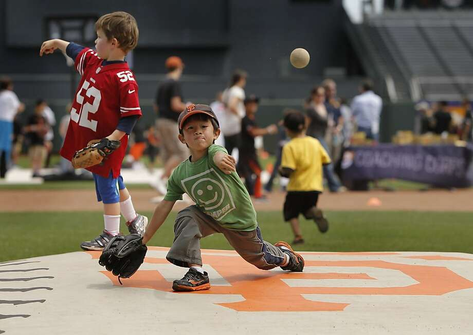 Left-hander Dylan Co, 4, of San Francisco throws some high heat off the mound at AT&T Park during Take the Field Day. Photo: Michael Macor, San Francisco Chronicle