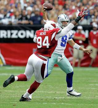 Dallas Cowboys quarterback Tony Romo (9) throws as Arizona Cardinals outside linebacker Sam Acho (94) defends during the first half of a preseason NFL football  game on Saturday, Aug. 17, 2013, in Glendale, Ariz. (AP Photo/Rick Scuteri) Photo: Rick Scuteri, Associated Press / AP 157181