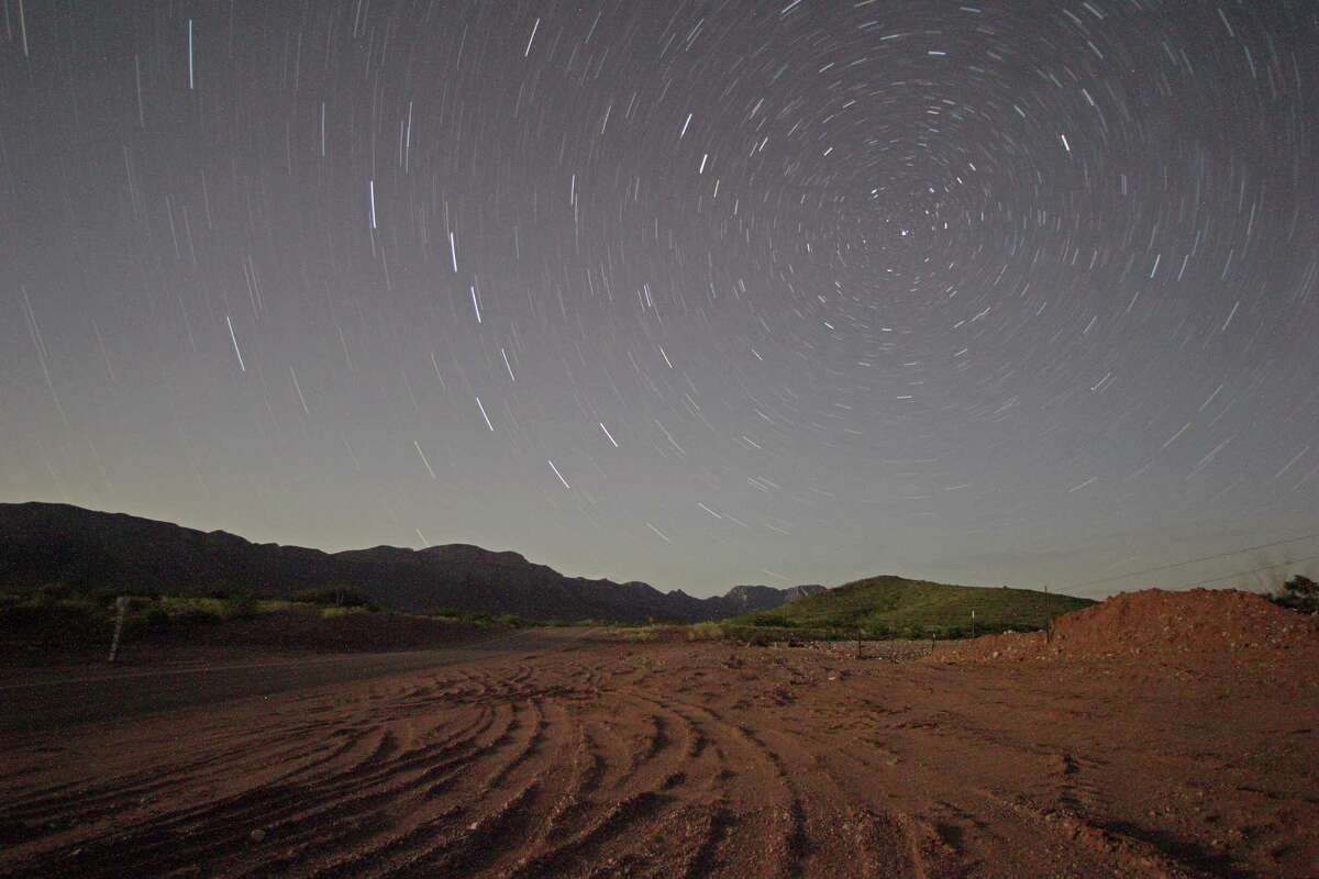 A long exposure photograph of Sierra Diablo mountain range land owned by Amazon.Com founder Jeff Bezos Monday, Aug. 12, 2013, in Van Horn.