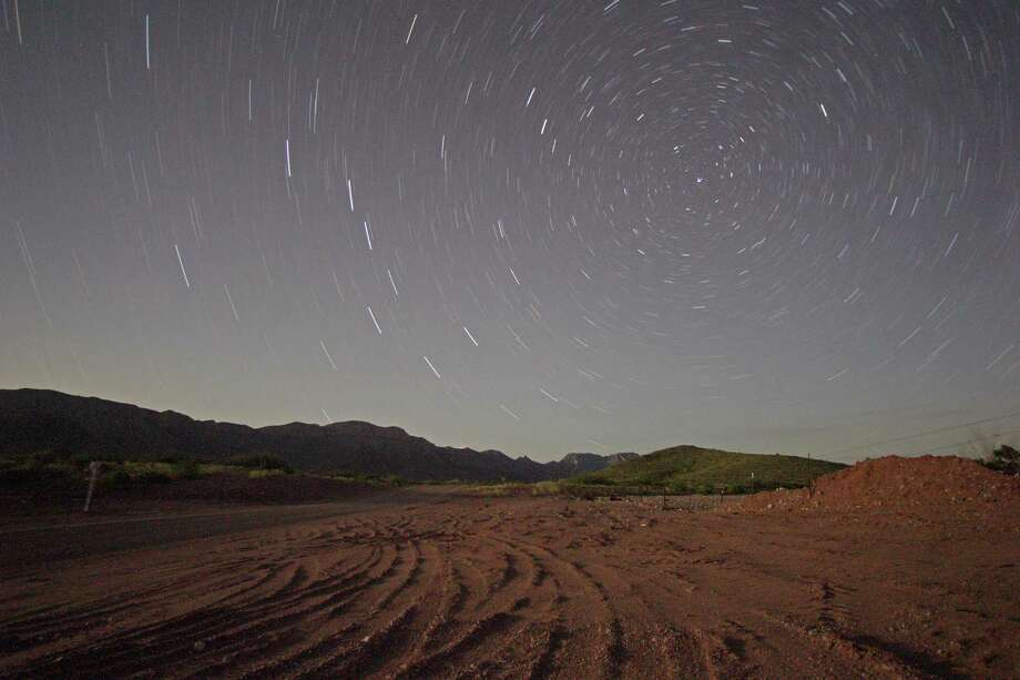 A long exposure photograph of Sierra Diablo mountain range land owned by Amazon.Com founder Jeff Bezos Monday, Aug. 12, 2013, in Van Horn. Photo: James Nielsen, Houston Chronicle / © 2013  Houston Chronicle