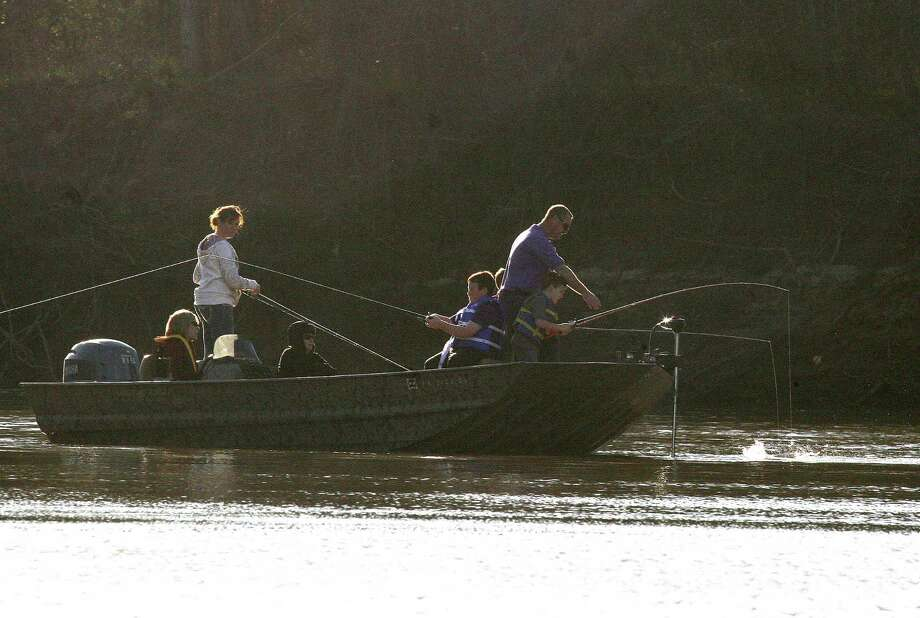 Families planning a fishing fling over the Labor Day weekend are among the hundreds of thousands of Texans who face having to purchase new fishing licenses before hitting the water on the holiday. New fishing and hunting licenses are required beginning Sept. 1. Photo: Picasa