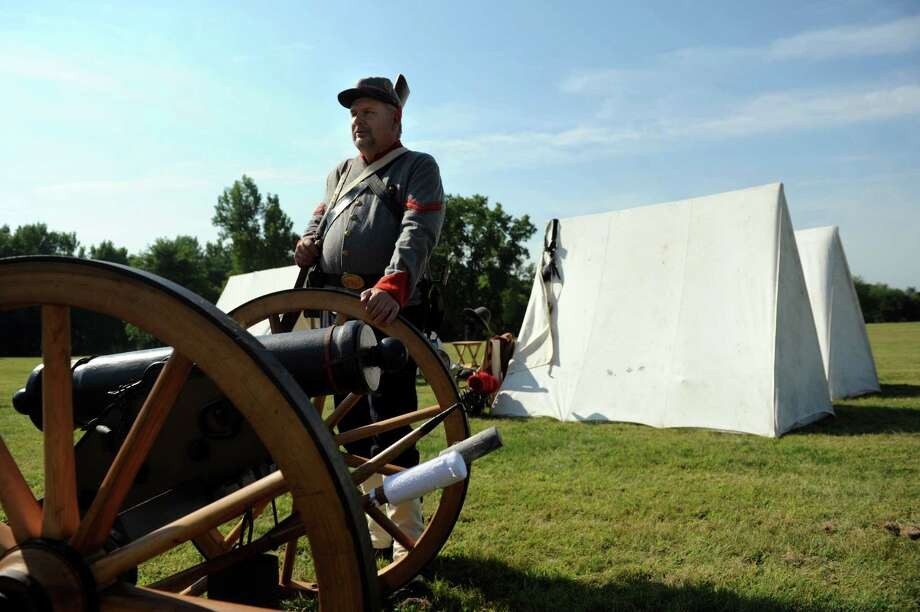 Pat Dolan of Ballston Spa, a reenactor with Morgan's Artillery, stands by a Mountain Howitzer cannon during Civil War Heritage Days on Saturday, Aug. 17, 2013, at Schuyler Flatts Cultural Park in Colonie, N.Y. The encampment continues Sunday from 10 a.m. to 4 p.m. (Cindy Schultz / Times Union) Photo: Cindy Schultz / 00023545A