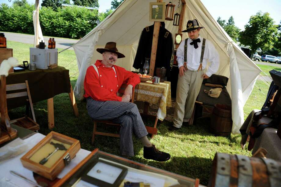 Bob Tillson of Middlebury, Vt. left, and Dan Celik of Brandon, Vt., living historians with the Civil War Medical Coalition, relax in the field dressing station during Civil War Heritage Days on Saturday, Aug. 17, 2013, at Schuyler Flatts Cultural Park in Colonie, N.Y. The encampment continues Sunday from 10 a.m. to 4 p.m. (Cindy Schultz / Times Union) Photo: Cindy Schultz / 00023545A