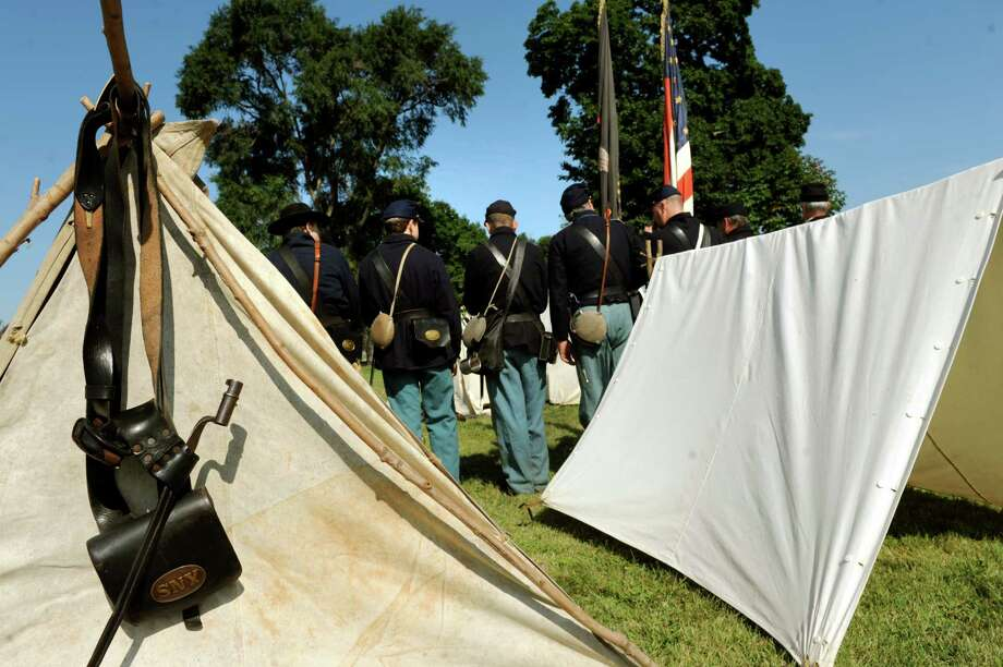 The 125th New York regiment lines up to march during Civil War Heritage Days on Saturday, Aug. 17, 2013, at Schuyler Flatts Cultural Park in Colonie, N.Y. The encampment continues Sunday from 10 a.m. to 4 p.m. At left is an ammunition box and bayonet. (Cindy Schultz / Times Union) Photo: Cindy Schultz / 00023545A