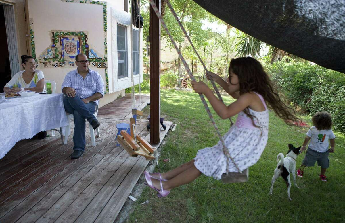 Micha Drori and his wife, Ora, enjoy their backyard garden of their house at the settlement of Barkan in the West Bank.