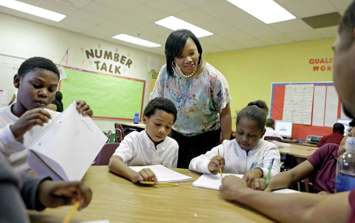 Burgess-Peterson Elementary School Principal Robin Robbins meets with students during an after-school study program in Atlanta in preparation for state standardized testing, of which most parents polled say their own children are given about the right number.