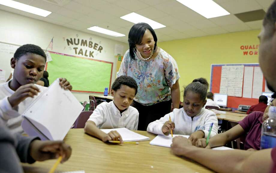 Burgess-Peterson Elementary School Principal Robin Robbins meets with students during an after-school study program in Atlanta in preparation for state standardized testing, of which most parents polled say their own children are given about the right number. Photo: David Goldman / Associated Press