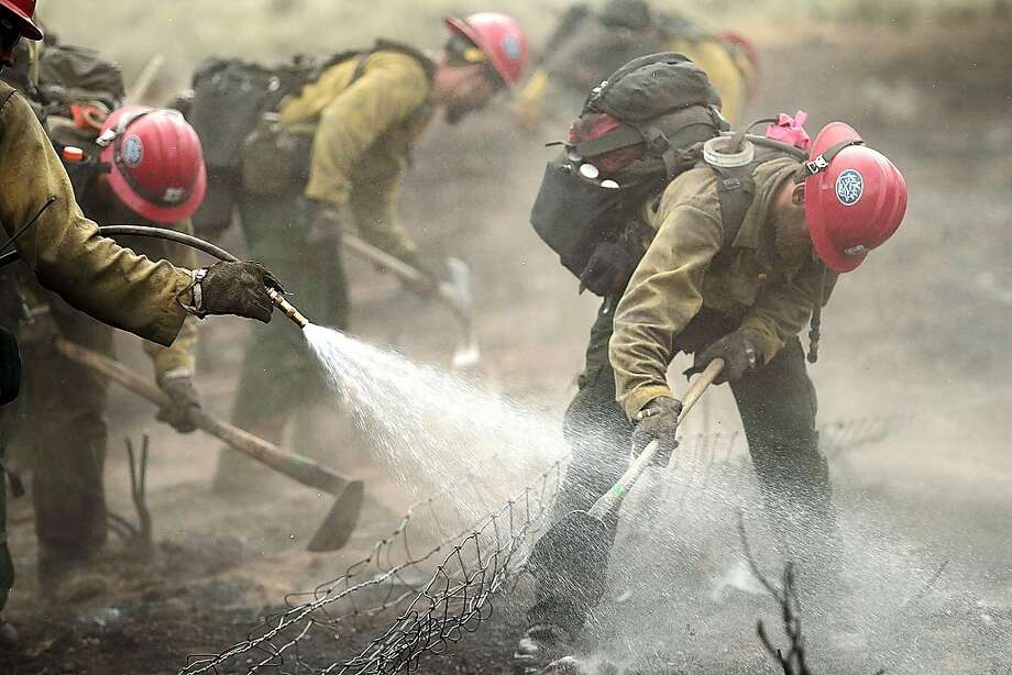 Members of the Prescott Hotshots clear part of the fast-moving Beaver Creek Fire, which has burned more than 140 square miles west of Hailey, Idaho. Photo: Ashley Smith, Associated Press