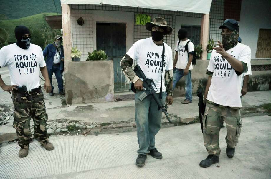 The growing violence in Mexico has spawned the rise of vigilante groups, some of which have been accused of being allies of drug cartels. Photo: Gustavo Aguado, STR / AP