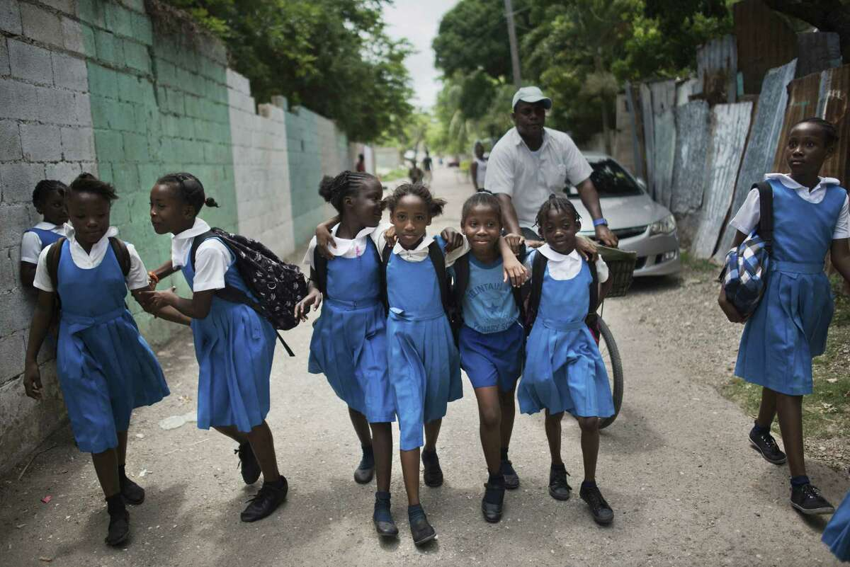 Young girls walk home after school in the once crime-ridden Mountain View neighborhood of Kingston, Jamaica, a country that is emerging as a rare bright spot in the hub of the fight against drugs and organized crime.