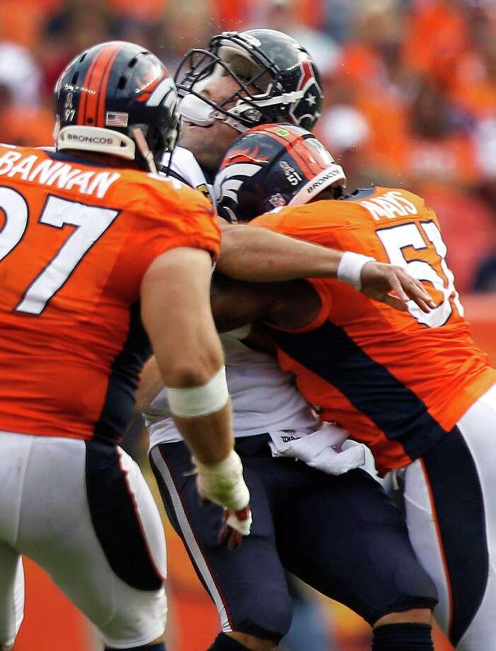 Joe Mays, right, was fined $50,000 for this hit on Texans quarterback Matt Schaub last season. Photo: Brett Coomer, Staff / © 2012  Houston Chronicle