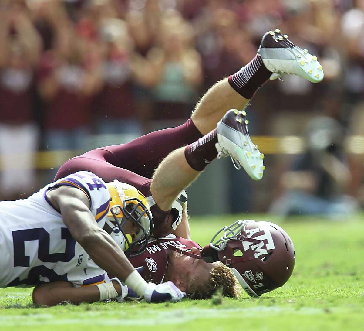 Texas A&M's Ryan Swope, right, crashing to the ground against LSU last year, retired from football because of concussions to spoil his dreams of playing in NFL.