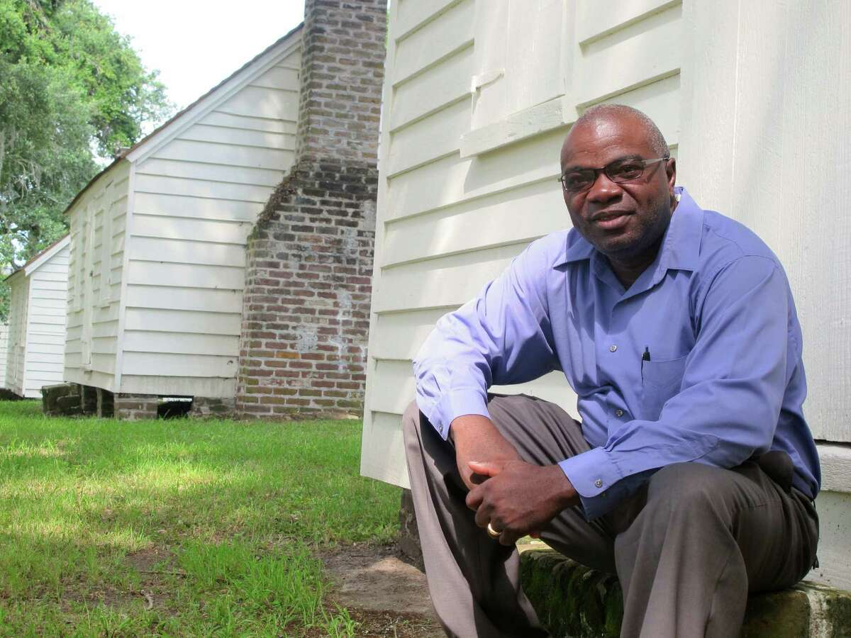 Joe McGill, who works with the National Trust For Historic Preservation, sits outside one of the slave cabins at McLeod Plantation in Charleston, S.C. As part of the Slave Dwelling Project, McGill has slept in old slave dwellings in a dozen states during the past three years.