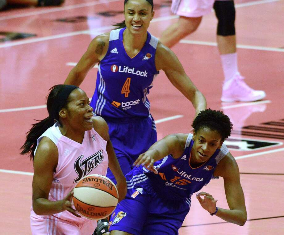 Jia Perkins of the San Antonio Silver Stars dribbles down the court as Briana Gilbreath (15) and Candice Dupree of the Phoenix Mercury give chase during WNBA action at the AT&T Center on Saturday, Aug. 17, 2013. Photo: Billy Calzada, San Antonio Express-News / San Antonio Express-News