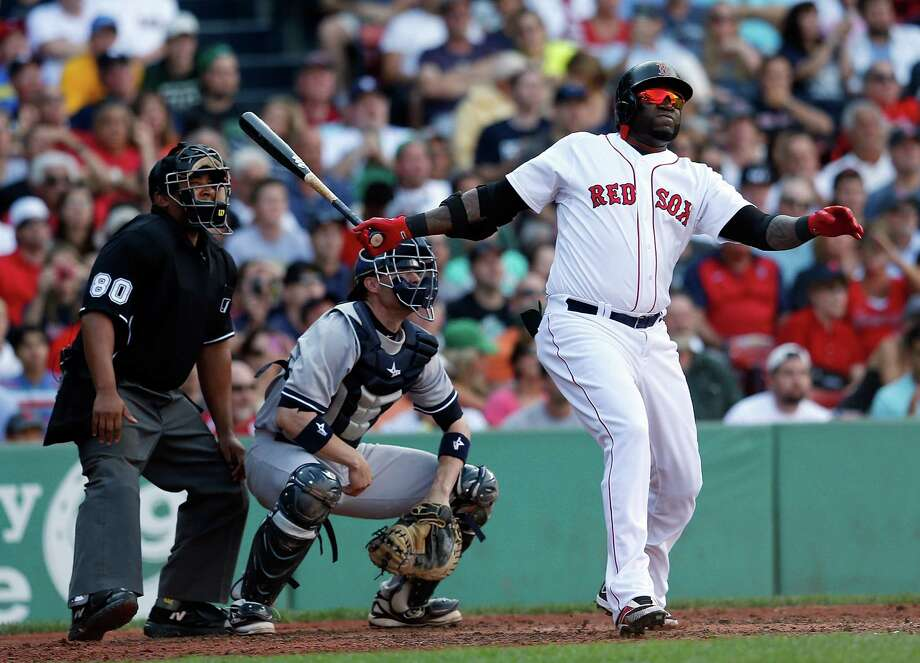 BOSTON, MA - AUGUST 17: David Ortiz #34 of the Boston Red Sox doubles against the New York Yankees in the 4th inning at Fenway Park on August 17, 2013 in Boston, Massachusetts. (Photo by Jim Rogash/Getty Images) ORG XMIT: 163495062 Photo: Jim Rogash / 2013 Getty Images