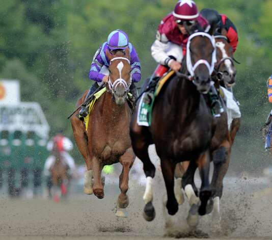 Princess of Sylmar with jockey Javier Castellano stalks behind the field the first time by the grandstand on her way to the win the 133rd running of The Alabama Aug 17, 2013 at the Saratoga Race Course in Saratoga Springs, N.Y.    (Skip Dickstein/Times Union) Photo: SKIP DICKSTEIN