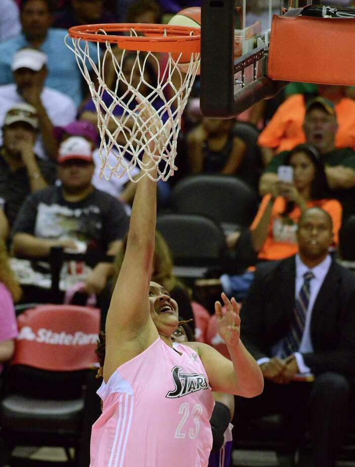 Danielle Adams of the San Antonio Silver Stars lays up the ball during WNBA action against the Phoenix Mercury at the AT&T Center on Saturday, Aug. 17, 2013. Photo: Billy Calzada, San Antonio Express-News / San Antonio Express-News