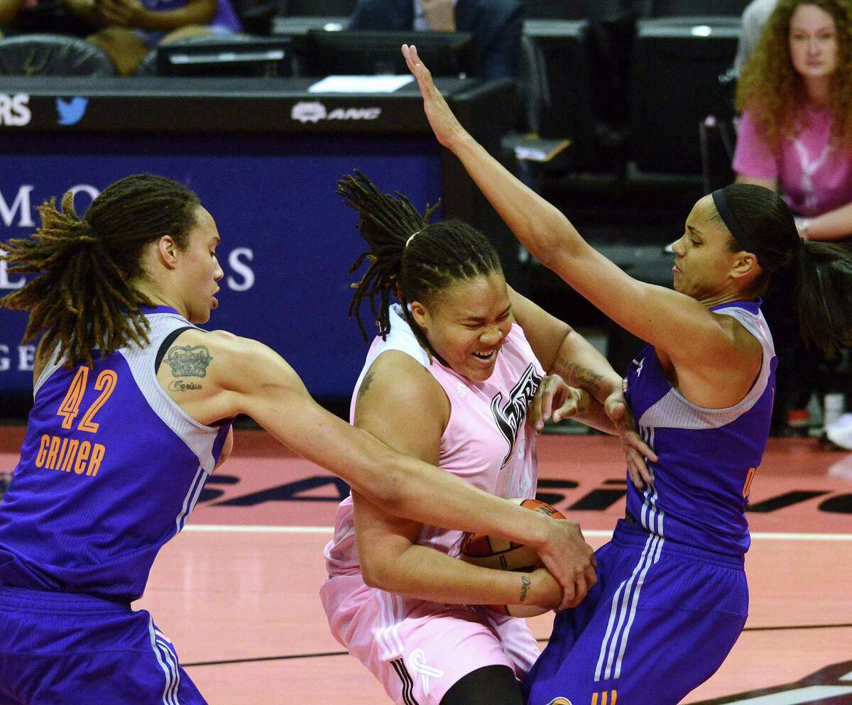 Danielle Adams of the San Antonio Silver Stars is tied up by Brittney Griner, left, and Candice Dupree of the Phoenix Mercury during WNBA action at the AT&T Center on Saturday, Aug. 17, 2013.