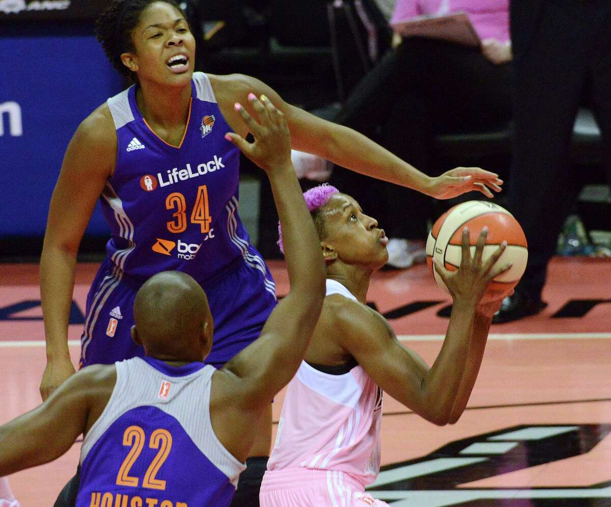 Danielle Robinson of the San Antonio Silver Stars penetrates as Charde Houston (22) and Krystal Thomas of the Phoenix Mercury defend during WNBA action at the AT&T Center on Saturday, Aug. 17, 2013.