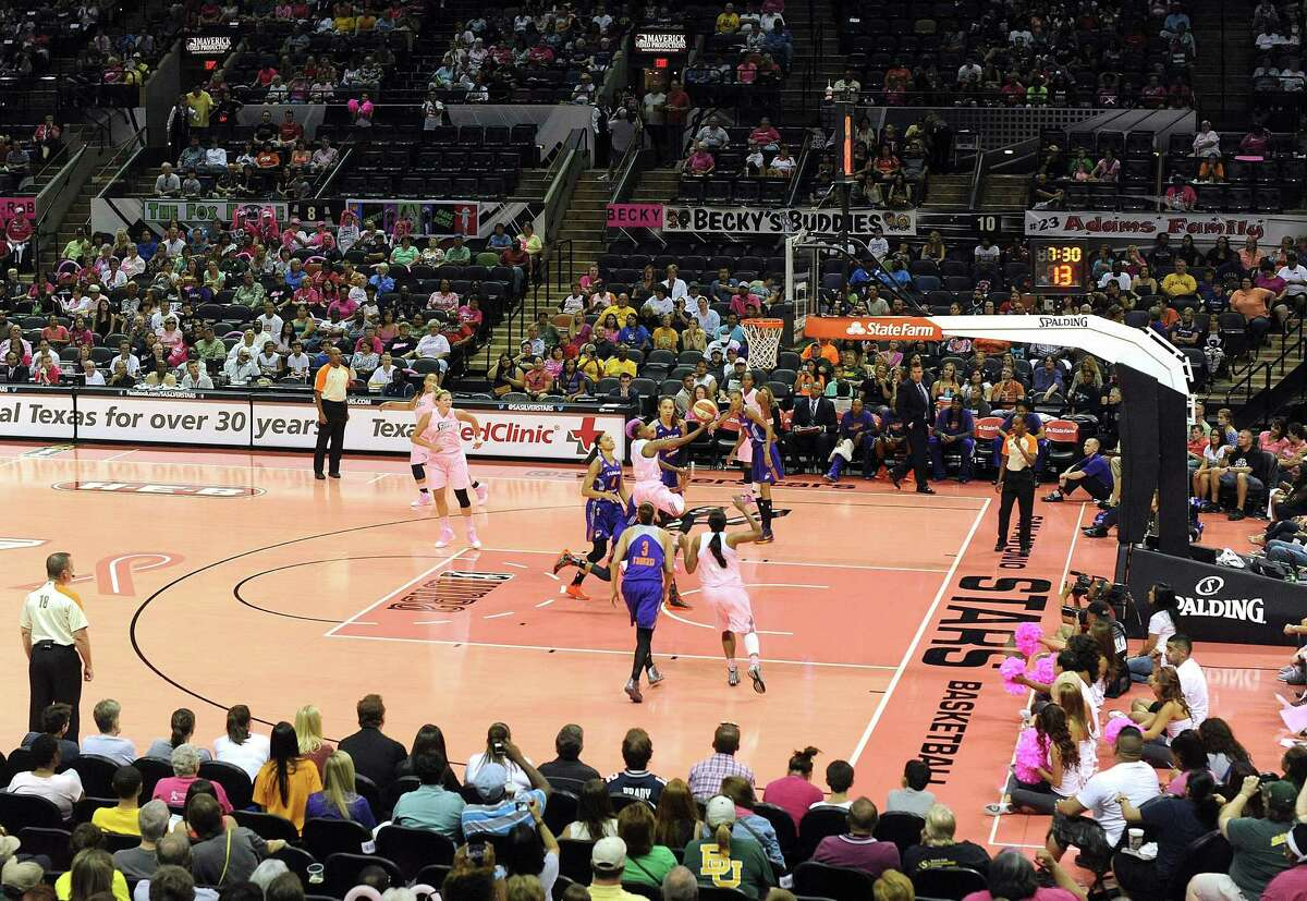 The Phoenix Mercury and San Antonio Silver Stars play on a pink basketball floor to mark Breast Health Awareness Night at the AT&T Center on Saturday, Aug. 17, 2013.