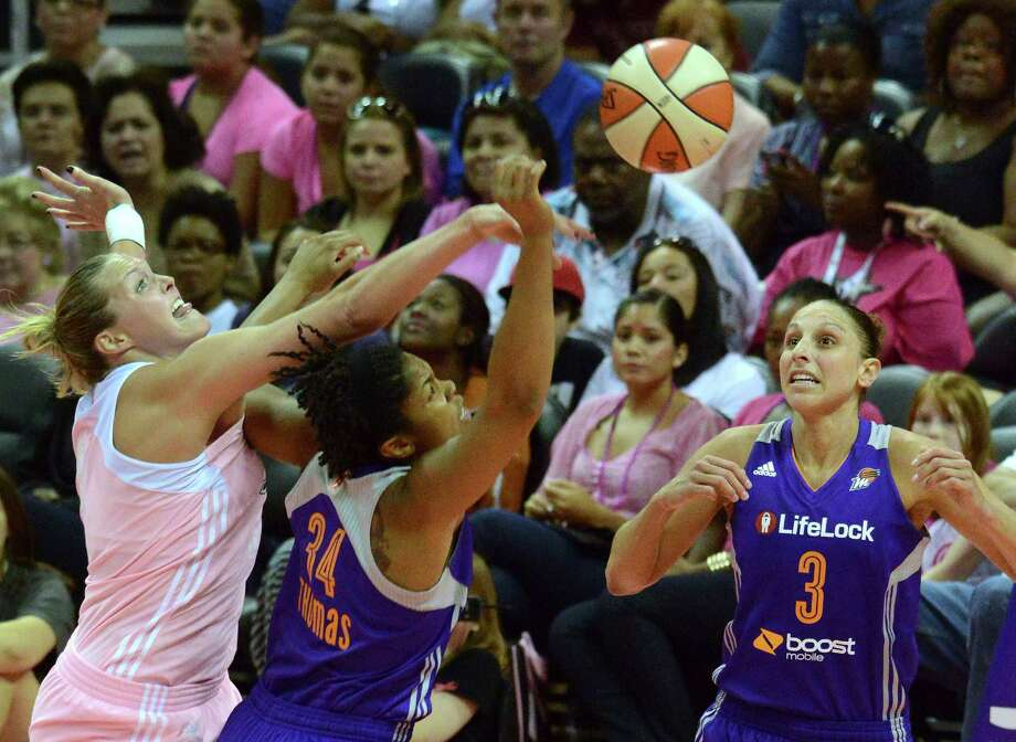 Jayne Appel of the San Antonio Silver Stars, left, fights Krystal Thomas (34) and Diana Taurasi of the Phoenix Mercury for a loose ball during WNBA action at the AT&T Center on Saturday, Aug. 17, 2013. Photo: Billy Calzada, San Antonio Express-News / San Antonio Express-News