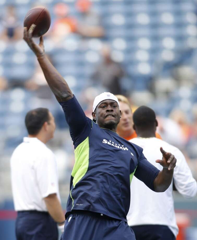 Seattle Seahawks backup quarterback Tarvaris Jackson passes during warmups prior to a preseason NFL football game against the Denver Broncos, Saturday, Aug. 17, 2013, in Seattle. (AP Photo/John Froschauer) Photo: AP