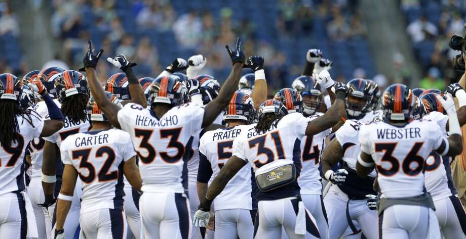 Denver Broncos players huddle on the field before a preseason NFL football game against the Seattle Seahawks, Saturday, Aug. 17, 2013, in Seattle. (AP Photo/Elaine Thompson) Photo: AP