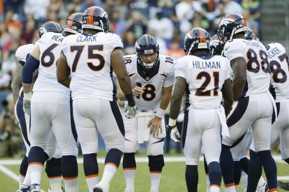 Denver Broncos quarterback Peyton Manning (18) huddles with his team in the first half of a preseason NFL football game against the Seattle Seahawks, Saturday, Aug. 17, 2013, in Seattle. (AP Photo/Elaine Thompson) Photo: AP