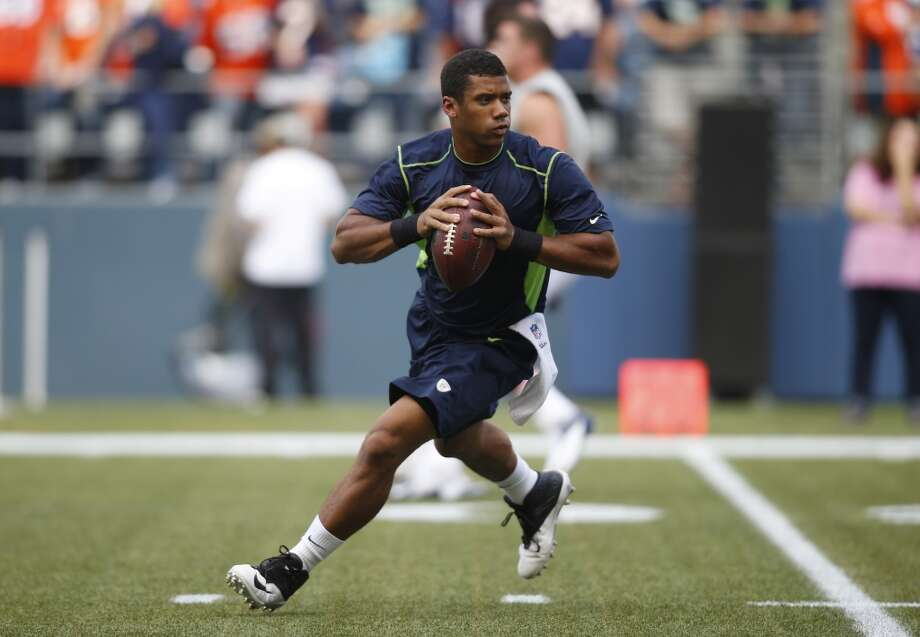 Seattle Seahawks quarterback Russell Wilson drops back to pass during pre-game warmups before an NFL football preseason game against the Denver Broncos, Saturday, Aug. 17, 2013, in Seattle. (AP Photo/John Froschauer) Photo: AP