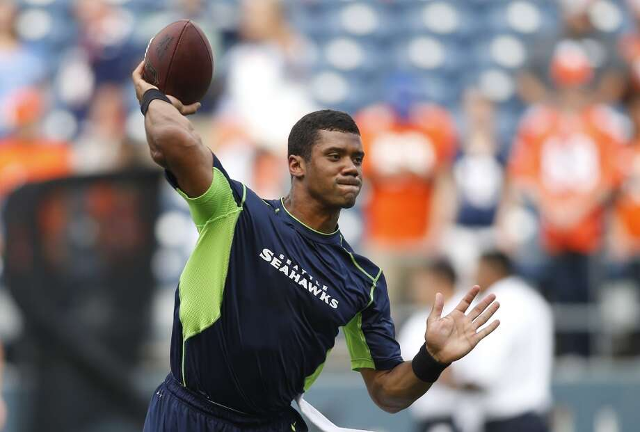 Seattle Seahawks quarterback Russell Wilson warms up for an NFL preseason football game against the Denver Broncos, Saturday, Aug. 17, 2013, in Seattle. (AP Photo/John Froschauer) Photo: AP