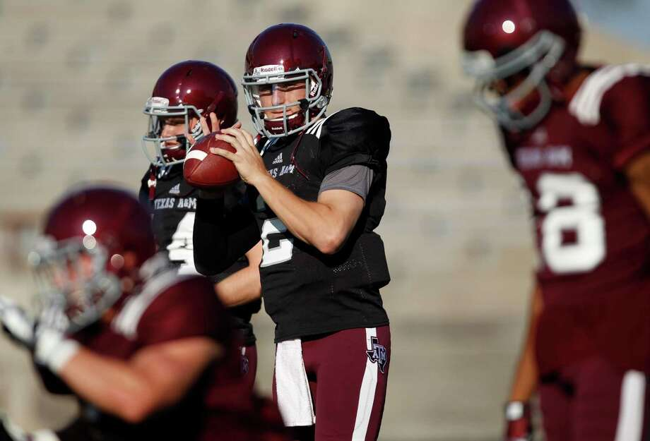Texas A&M quarterback Johnny Manziel (2) warms up before an intersquad scrimmage game, Saturday, August 17, 2013 at Kyle Field in College Station, TX. Read more on ExpressNews.com: All's right in Aggieland as Manziel takes most snaps at scrimmage Photo: Eric Christian Smith, For The Chronicle