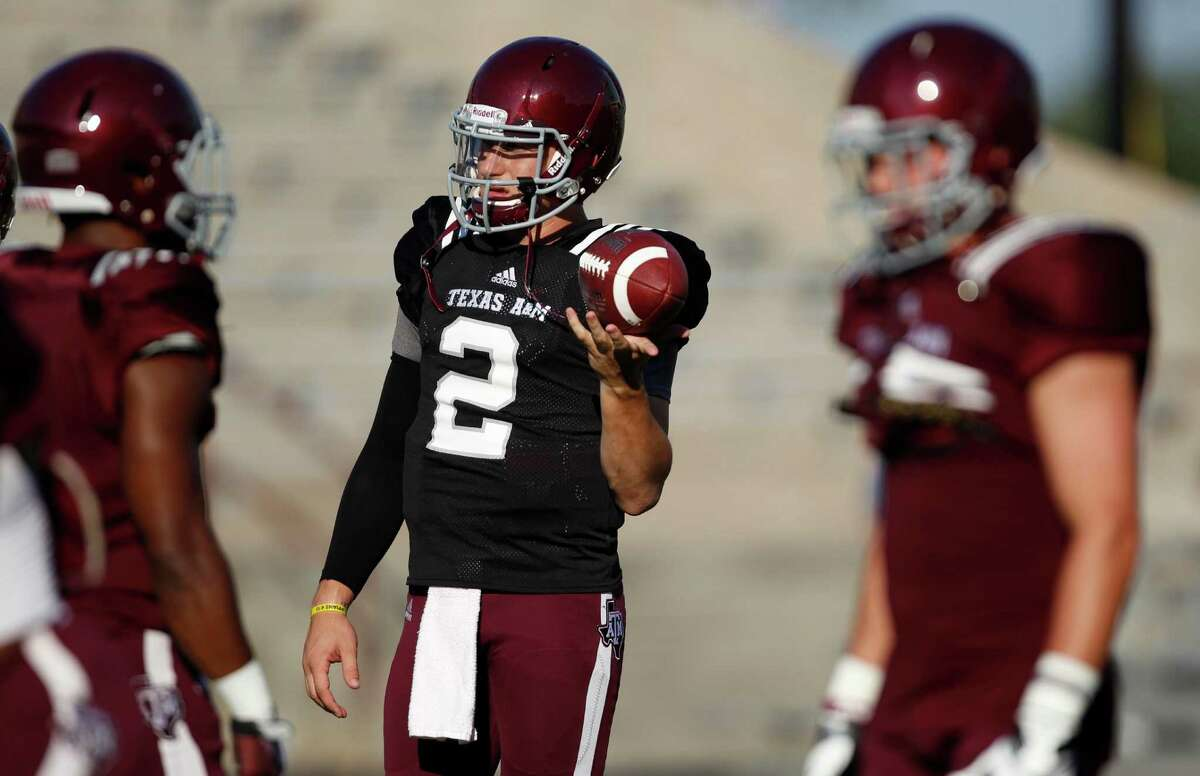 Texas A&M quarterback Johnny Manziel (2) warms up before an intersquad scrimmage game, Saturday, August 17, 2013 at Kyle Field in College Station, TX.