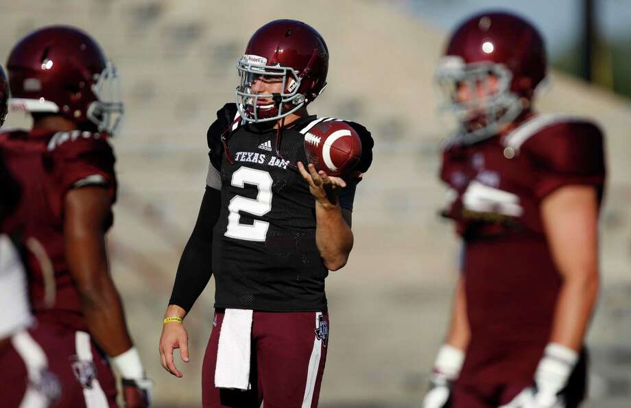Texas A&M quarterback Johnny Manziel (2) warms up before an intersquad scrimmage game, Saturday, August 17, 2013 at Kyle Field in College Station, TX. Photo: Eric Christian Smith, For The Chronicle