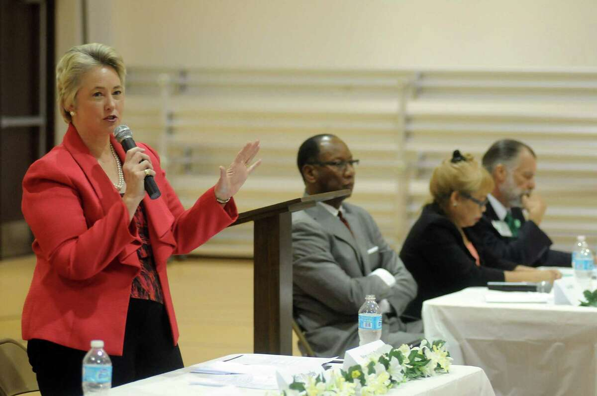 Mayor Annise Parker and Ben Hall appear at a political event sponsored by the Baptist Ministers Association of Houston at the J.J. Roberson Family Life Center.